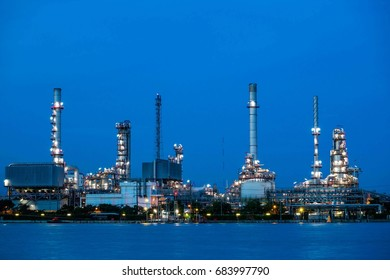 Oil refinery plant near river at twilight, Business and  Industry concept