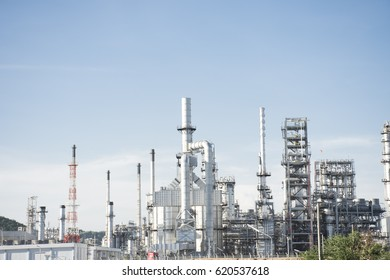 oil refinery plant on blue sky background.