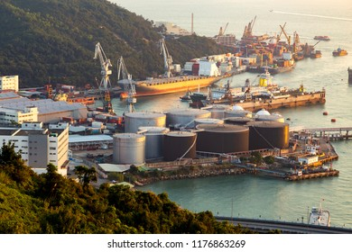 oil refinery plant in the port area for the chemical industry with various metal pipes and storage tanks.