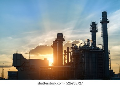 Oil refinery plant at sunrise with sky background