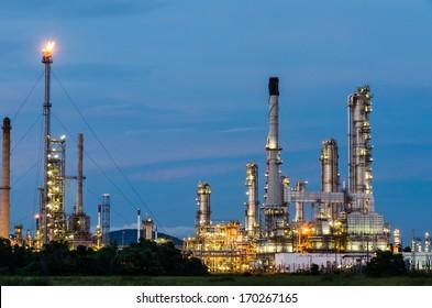 Oil refinery plant at twilight dark blue sky.