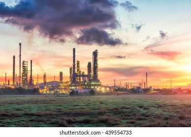 Oil refinery plant at twilight with sky background, petrochemical plant in night time,