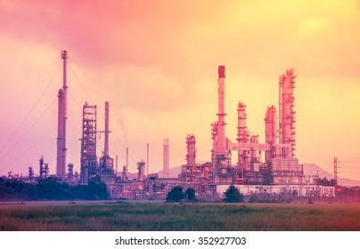 Oil refinery plant at twilight.vintage retro style.
