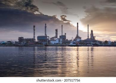 Oil refinery with sunset background