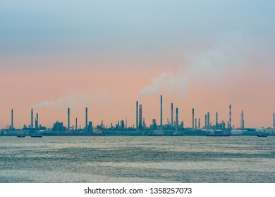 Oil refinery at sunset on Bukom Island in Singapore