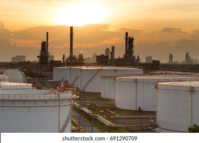 Oil refinery and oil thank in sunset background.
