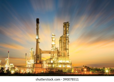 Oil refinery at twilight with dark sky background.