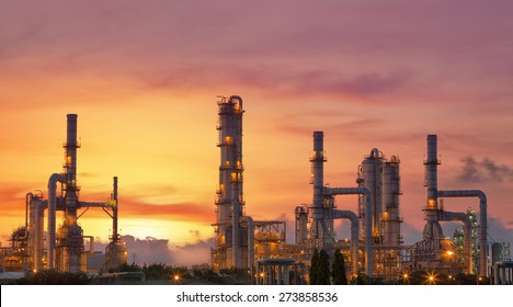Oil refinery at twilight sky, close up to pipe line