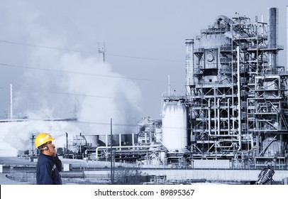 oil refinery and worker