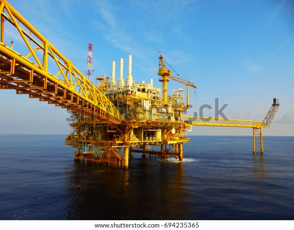 Oil rig with Oil and gas industrial platform for produced crude oil, natural gas and produced water in offshore or gulf, petroleum field.