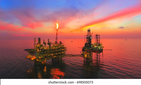 Oil Rig at late evening (offshore) areal photography during sunset.