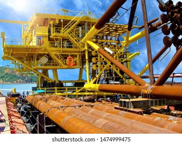 Oil rig platform during construction site in the harbor yard and workers preparing to move into the vessel to be installed in offshore locations.  - image Film grain effect