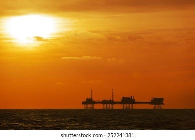 oil rig silhouette on the North Sea