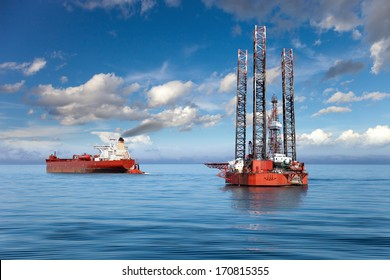Oil rig and tanker ship on offshore area.