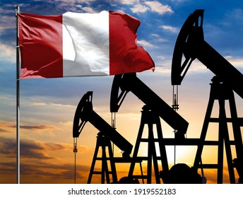 Oil rigs against the backdrop of the colorful sky and a flagpole with the flag of Peru. The concept of oil production, minerals, development of new deposits.
