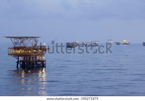 Oil rigs in an open sea