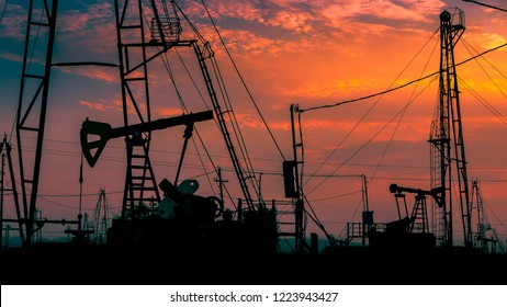 Oil rigs at sunset, industrial background
