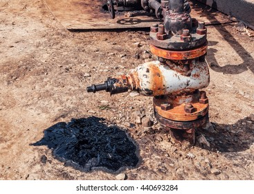 oil spill and old rusty valve