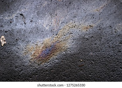 Oil spill wet asphalt pavement texture surface