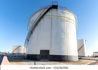 Oil storage tank farm in the petroleum refinery. Above ground storage tanks can be used to hold materials such as petroleum, waste matter, water, chemicals, and other hazardous materials.