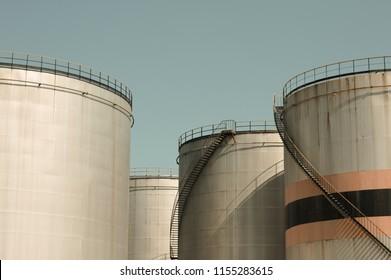 Oil storage tank with metal bridge and stairs (Pesaro, Italy, Europe)