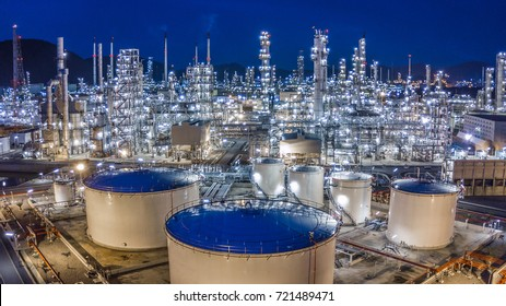 Oil storage tank with oil refinery background, Oil refinery plant at night.