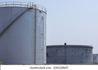 Oil storage tanks in tank farm with iron staircase. Military storage tank for petrol or diesel.Diesel tank is shorter than a gasoline tank because diesel mass weighs more petrol may be damaged storage