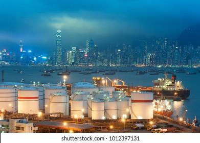 Oil tank in Victoria harbor of Hong KOng city at night