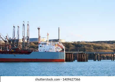 Oil tanker alongside refinery jetty Milford Haven