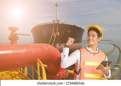 Oil tanker boat and Asian worker staff engineer hold tablet