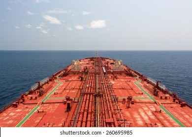 Oil tanker deck under blue sunny sky. View from monkey deck. - stock photo