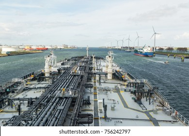 Oil tanker is leaving the port of Rtooterdam.