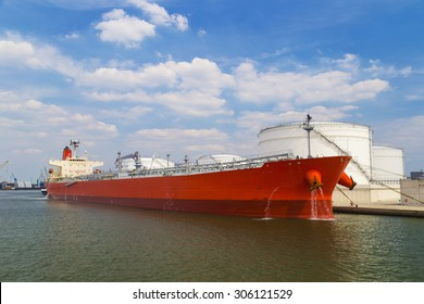 Oil tanker moored near an oil silo in Port of Antwerp, Belgium