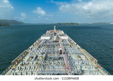 Oil tanker proceeding through the Panama Canal.