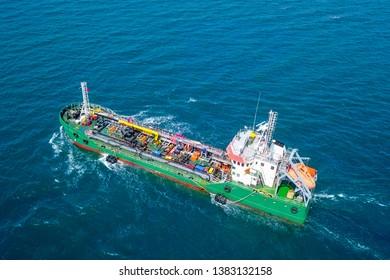 Oil tanker roaring across The Mediterranean Sea, Aerial image.