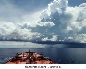 Oil tanker sailing in the Indian ocean facing an upcoming terrible storm