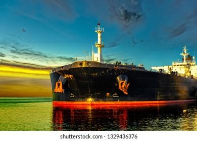 Oil Tanker in the sea at sunrise.
