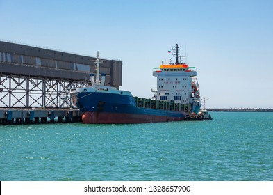 Oil tanker ship loading in port in the harbor of the Tuapse town, Russia