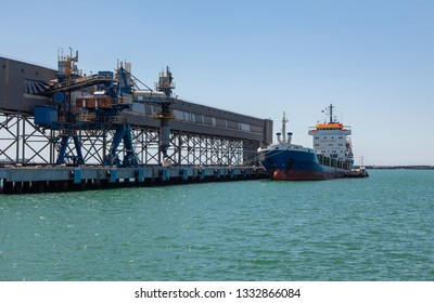 Oil tanker ship loading in sea port in the harbor of the Tuapse town, Russia, logistic import export business and transportation