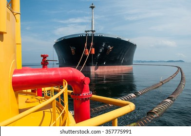 Oil tanker is transferring supply to the cargo vessel.