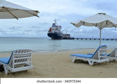 oil tanker transport ship at pier Picnic Center Beach Corn Island, Nicaragua, Central America