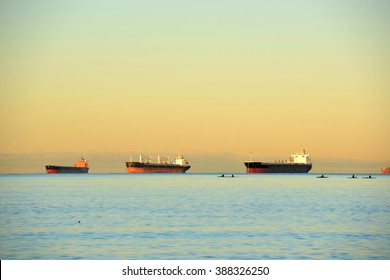 Oil Tankers docked at Port of Vancouver at sunrise, Vancouver, British Columbia, Canada.
