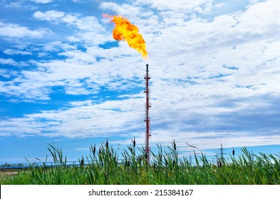 Oil torch on background of cloudy sky