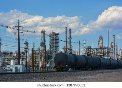 Oil Train on Tracks Next to a Refinery