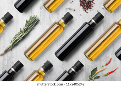 Oil vinegar bottles composition mockup on white wooden background, with spices and blank label to place your design
