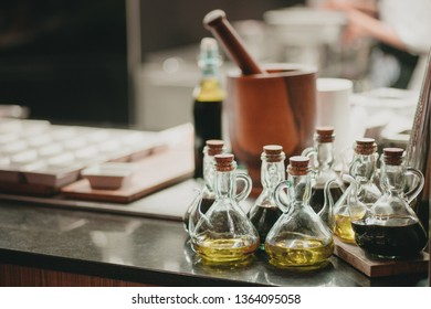 Oil and Vinegar Bottles on Inox Table in a Hotel Restaurant Professional Kitchen