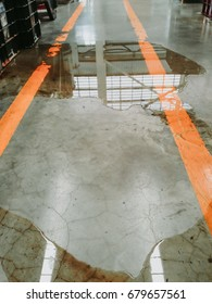oil or water leak on concrete floor , need clean and careful danger and accident
