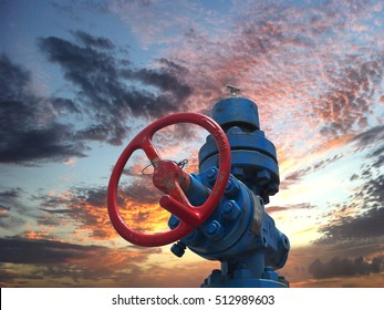 Oil well production site with sky during sunset