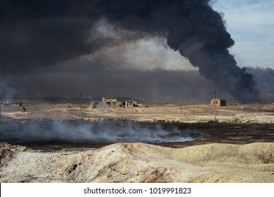 An oil well set on fire by the ISIS to slow down the coalition's advance, the fire was extinguished, in the background the black smoke of another oil well still on fire.Qayyarah (IQ) 2016/Nov/26