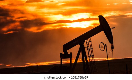 An oil well silhouette in the North Dakota sunset.